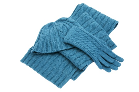 Blue wool knitted set isolated on white Stock Photo
