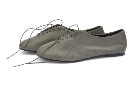 Gray leather shoes with laces on white Stock Photo - 11909433