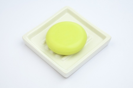Green Soap in soap-dish on blue