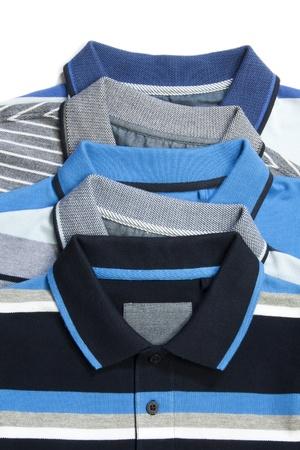 Een deel van stapel van vijf man polo kleding Stockfoto