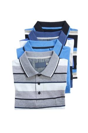 Pile of man polo shirts on white
