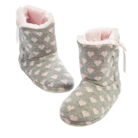 Home knitted ugg boots with fur inside on white photo