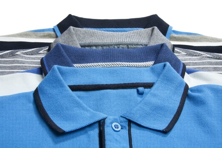 Een deel van een man polo shirts op wit Stockfoto