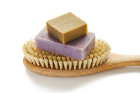 bristle: Two soap bars with natural ingredients on massage brush