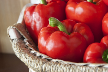 Red peppers in basket macro Stock Photo - 13733816