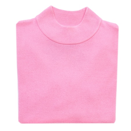 Pink folded woman knitted blouse on white isolated photo