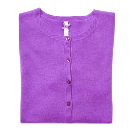 Folded lilac woman cardigan on white isolated