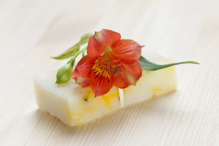 Soap bar with natural ingredients and flower photo