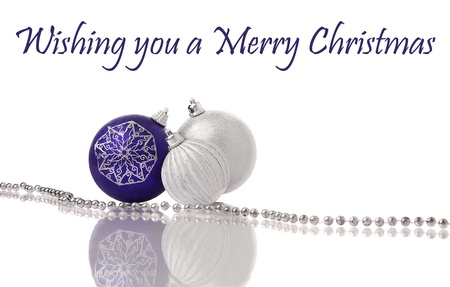 Christmas decoration purple and silver balls on white with reflection photo