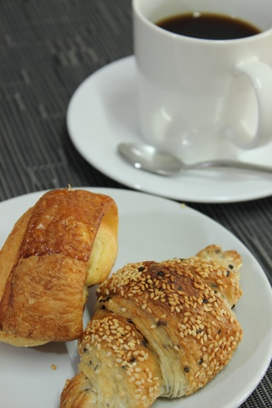 bread with black coffee photo