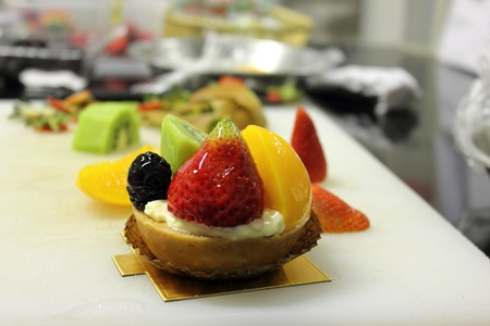 mixed fruit tart with glaze on top photo
