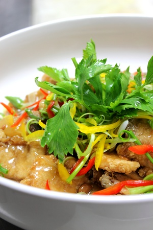 A cooked fish with chilli decorate Coriander photo