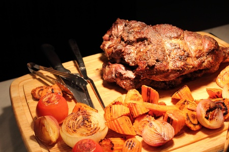 A Roast lamb leg on board carve