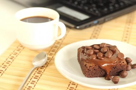 chocolate cake and a coffee photo
