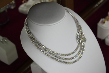 diamond necklace: counter with garnet jewelry in store window Stock Photo