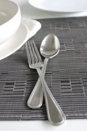 Spoon and Fork with a white bolw Stock Photo