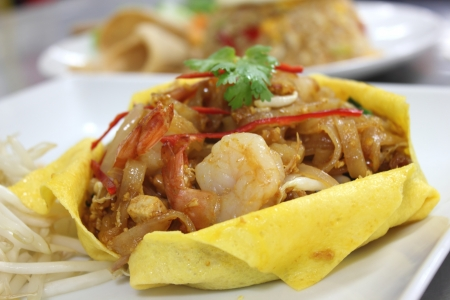Thai stir-fried  shrimp wrapped in a egg sheet. photo