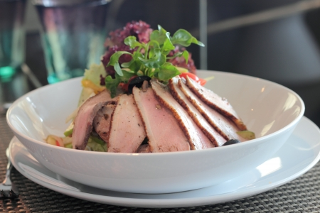 Sliced roast duck salad with vegetable variety photo