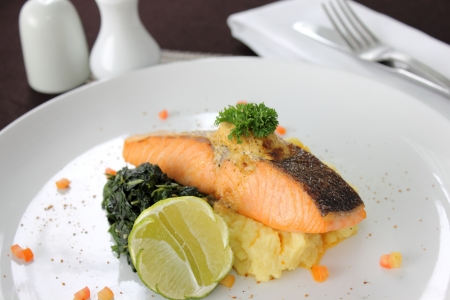 Salmon steak with sauce and boiled vegetables photo