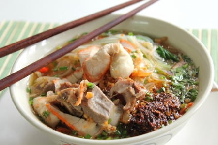A rosted  pork Noodles soup with Chopsticks photo