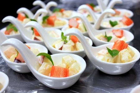 Potato salad and crab in White spoon Stock Photo