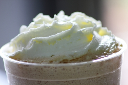 The Iced coffee decorated with whipped cream photo