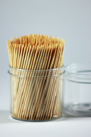 A Apple on the toothpicks. Grey background photo