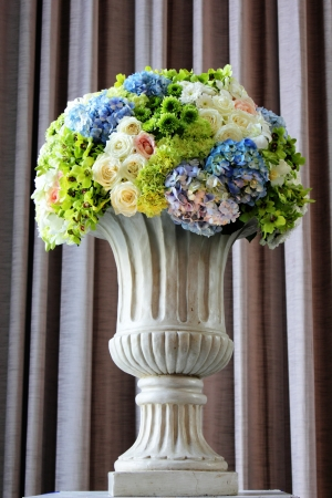 flowers in a vase with a bow photo