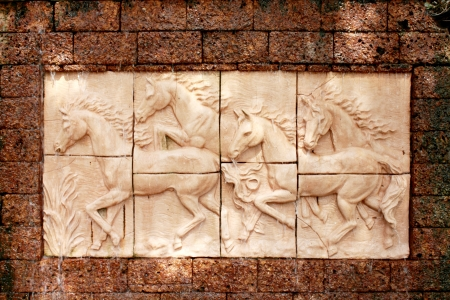 A horses Carving on a buddhism temple wall photo