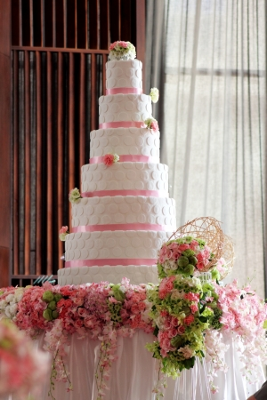 tiered:  A wedding white cake decorated with  flower Stock Photo