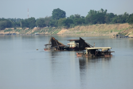River cargo ship transporting gravel and sand photo