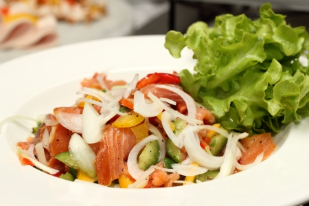 Salad - smoked salmon with vegetables in white bolwe photo