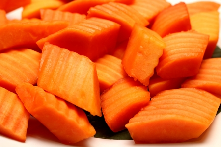 A Tropical papaya fruit slices on plate Stock Photo