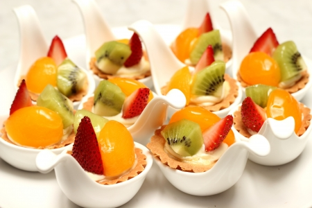 A delicious fruit tart witth peach and strawberries Stock Photo