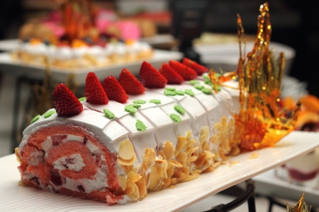 A Swiss roll filled with cream and strawberries photo