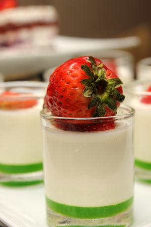 A Panacotta dessert with strawberry on the top.  photo
