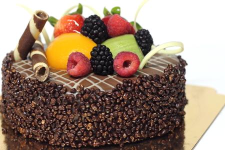 ganache: A Delicious chocolate strawberry cake with chocolate ganache.  Stock Photo