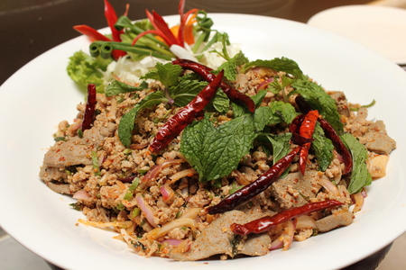 Larb pork spicy salad.Traditional Thai food Close up.  photo