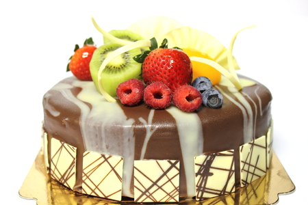 A Chocolate cake and topped with fresh fruit.  Stock Photo