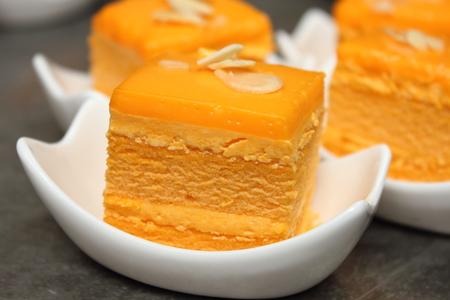 orange cake: A orange cake with almond slice on top