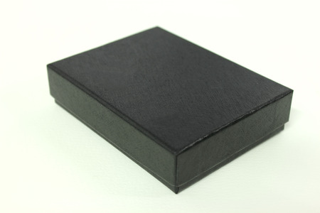 A Black paper box on white background.  Stock Photo