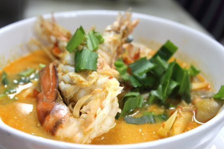 Sour and Spicy soup with Prawn [Thais Tomyum kung ]in a bowl. photo