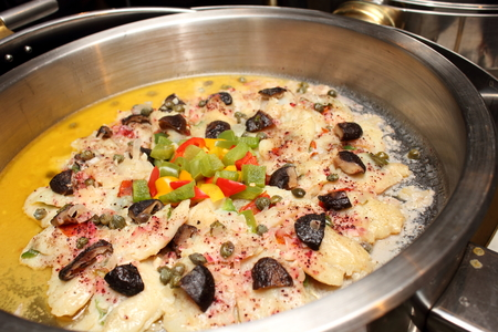 Steamed snapper fish with butter sauce in dish.  photo