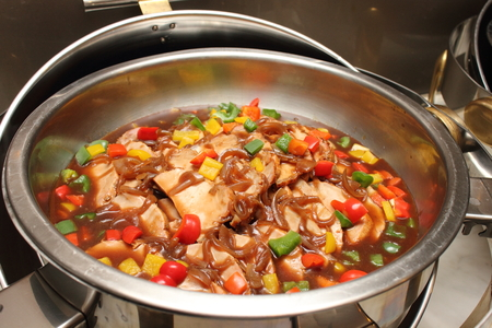 chafing dish: Chafing dish heater filled with ready food inside.   Stock Photo