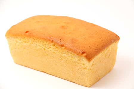 A butter cake on a white background.