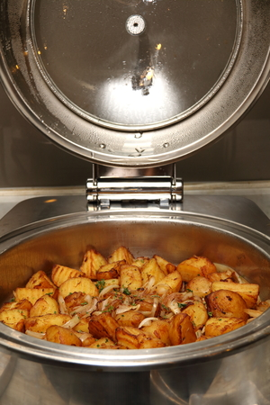 chafing dish: Chafing dish heater filled with ready food inside.