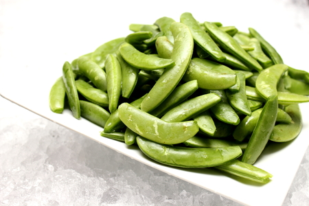french bean: French green bean string on white background.