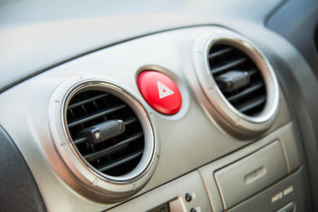 Closeup of an air vent for controlling airflow in an automobile.
