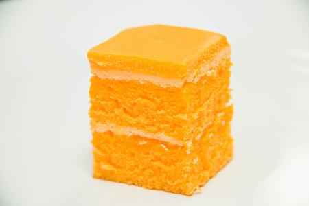 white back ground: Orange cake on a white back ground.