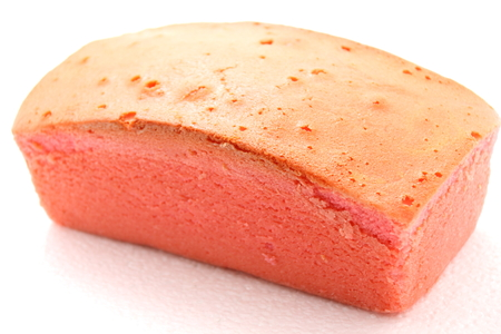 spongy: A pink Butter Cake on white background. Stock Photo